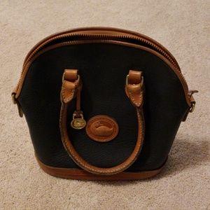 Vintage Dooney and Bourke navy leather handbag